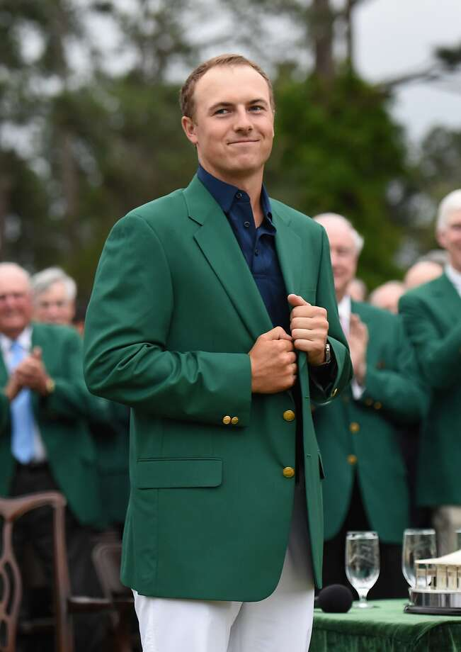 Jordan Spieth dons the Green Jacket as the 2015 Masters Champion at the 79th Masters Golf Tournament.