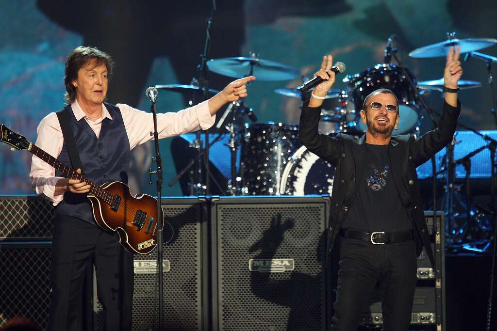 FILE - In this Jan. 27, 2014 file photo, Paul McCartney, left, and Ringo Starr perform at The Night that Changed America: A Grammy Salute to the Beatles in Los Angeles. McCartney will induct his former Beatle mate, Ringo Starr, into the Rock and Roll Hall of Fame next month. The 30th annual induction ceremony is scheduled for Cleveland's Public Hall on April 18. (Photo by Zach Cordner/Invision/AP, File) Photo: Zach Cordner, Associated Press