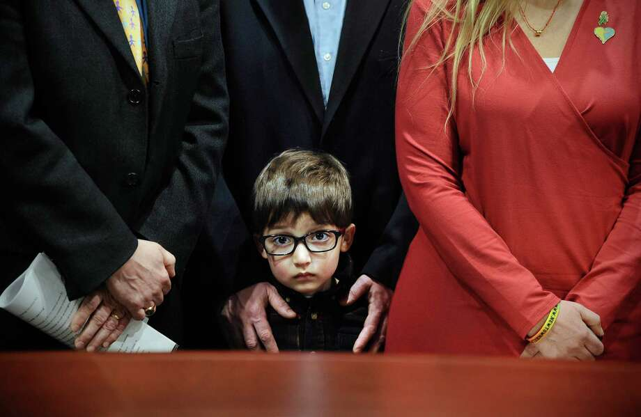 "Hayden Lewis of Norwalk, Conn., cousin of Sandy Hook School shooting victim Jesse Lewis, stands with family during a news conference. Days before his death, Lewis wrote ""nurturing, healing and love"" on his kitchen chalkboard. Those words have become the basis for a bill to train teachers in social and emotional learning.   Photo: Jessica Hill, FRE / FR125654 AP"