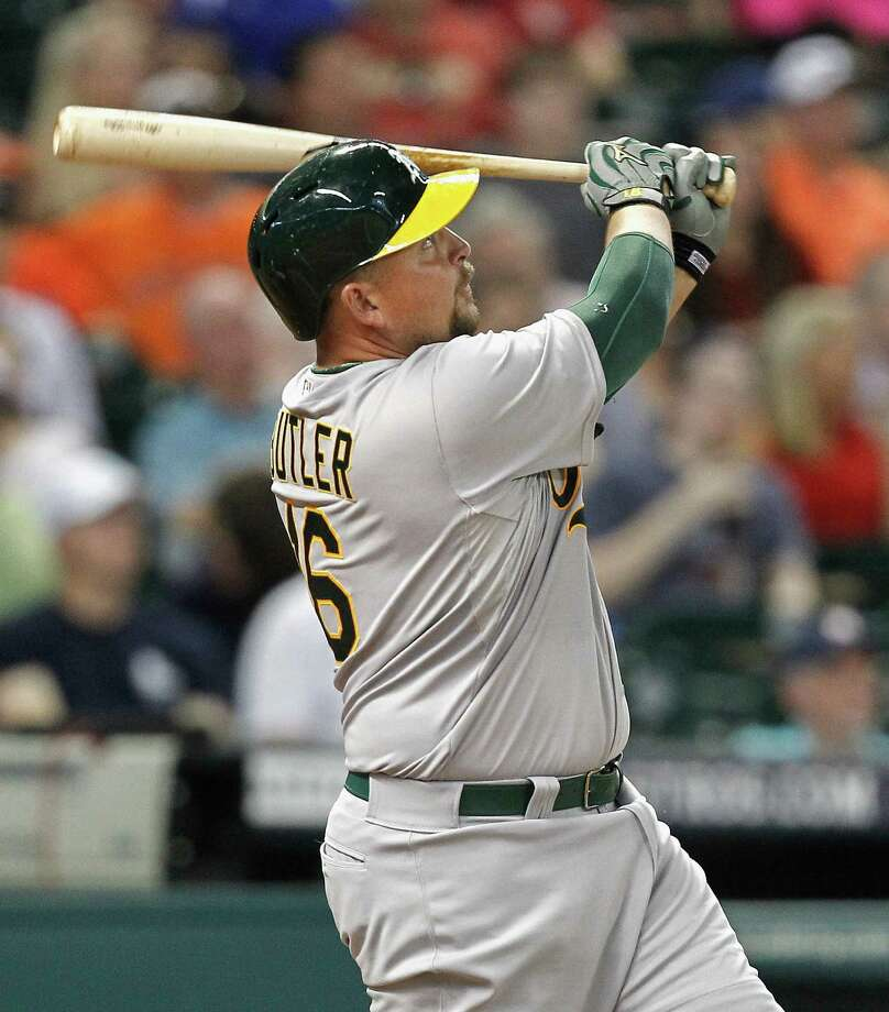 Billy Butler of the A's hits his first home run of the season, a three-run shot, against the Astros at at Minute Maid Park on Monday. Photo: Bob Levey / Getty Images / 2015 Getty Images
