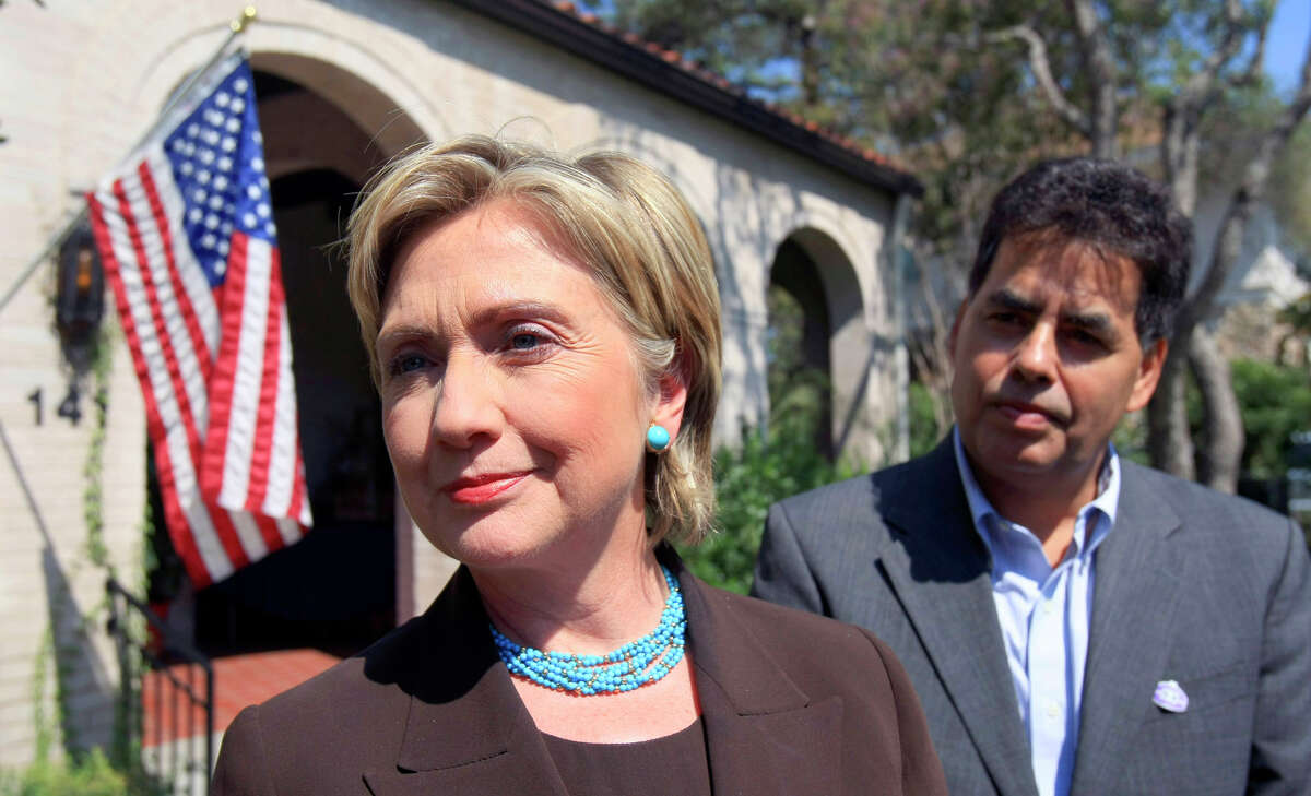 Former presidential candidate Sen. Hillary Clinton, D.-N.Y., speaks to the media Friday Oct. 3, 2008 flanked by Jose Villareal after attending a private fundraiser at the Villarreal's Monte Vista home.