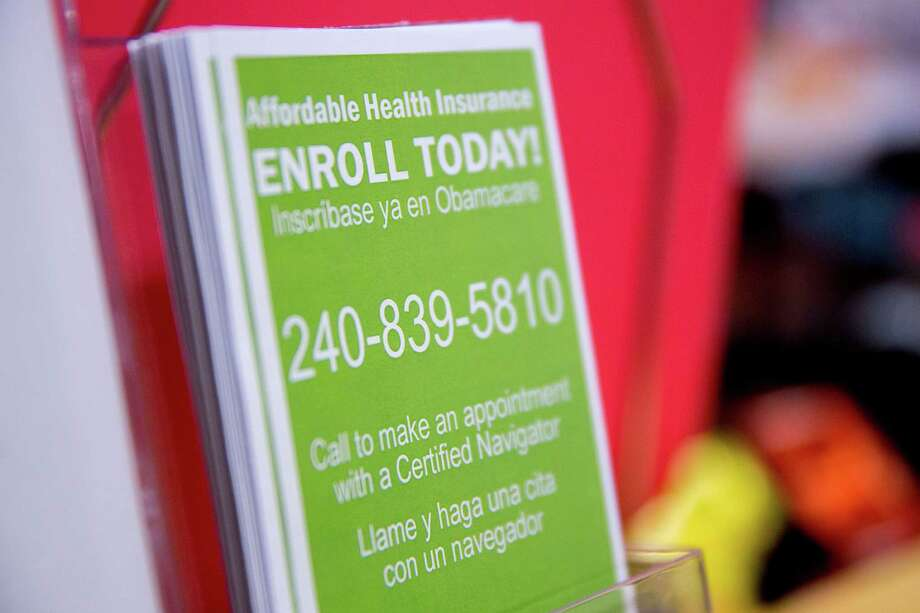 An enrollment pamphlet on display at a health center in Silver Spring, Md., offers information about obtaining Affordable Care Act insurance coverage. Photo: Andrew Harrer / © 2015 Bloomberg Finance LP