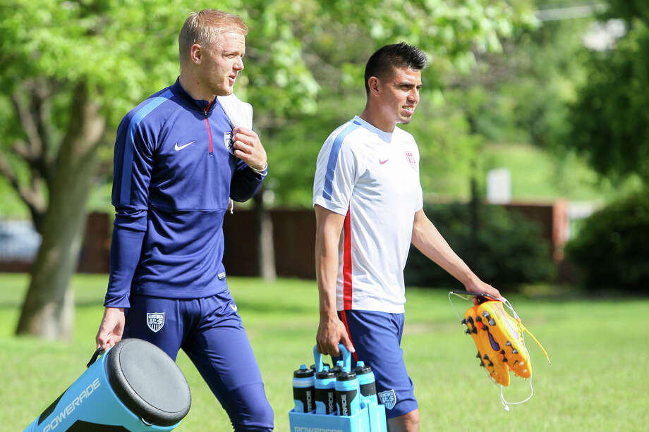 Goalie William Yarborough (left), from Aguascalientes, Mexico, and midfielder Joe Corona, from Chula Vista, CA, arrive with the U.S. men's national soccer team for a practice session at Trinity University's McGinlay Soccer Field on Monday, April 13, 2015.  MARVIN PFEIFFER/ mpfeiffer@express-news.net Photo: Marvin Pfeiffer, Staff / San Antonio Express-News / Express-News 2015