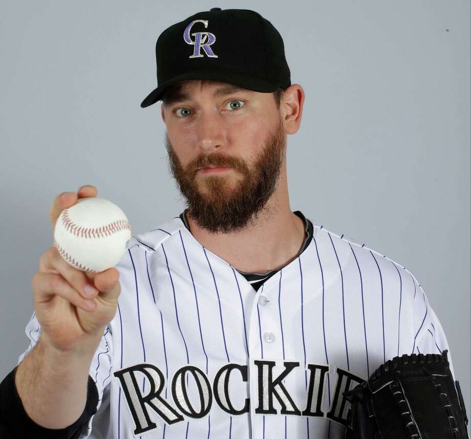 "FILE - In a March 2015 file photo, John Axford of the Colorado Rockies baseball team poses for a photo in Scottsdale, Ariz. Axford's 2-year-old son is improving following a rattlesnake bite. Jameson Axford remained hospitalized for an eighth straight day, but Axford said Wednesday, Apri his son was able to sleep through the night as he deals with pain. Doctors have saved his right foot, but there is fear one of his toes may need to be amputated. ""It's looking better,"" Axford said. ""We're going by doctors' orders. They know more than we do. We're going to trust them to heal him the best way possible."" (AP Photo/Darron Cummings, File) Photo: Darron Cummings, STF / AP"