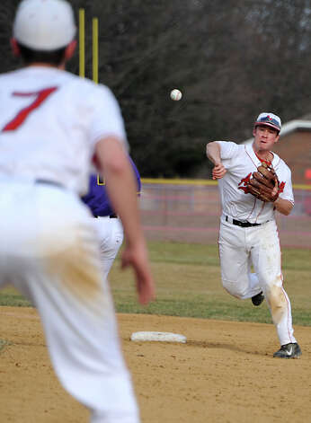 Albany Academy shortstop Trevor Francesconi turns a double play during a baseball game against Voorheesville at Albany Academy on Monday, April 13, 2015 in Albany, N.Y. (Lori Van Buren / Times Union) Photo: Lori Van Buren / 00031406A