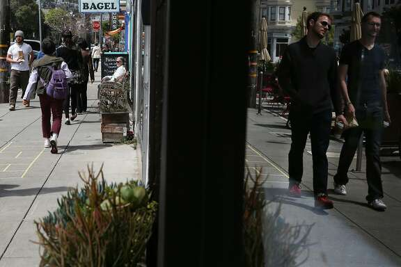 24th Street in Noe Valley is busy with shoppers and pedestrians on Monday, April 13, 2015.