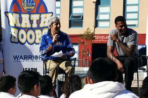 Warriors announcer Matthew Hurwitz and Warriors guard Brandon Rush talk to kids about the importance of math in everyday life at the Math Hoops Live event at Cleveland Elementary School in San Francisco, Calif., Friday April 10, 2015.