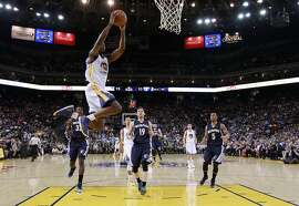 Golden State Warriors' Harrison Barnes (40) goes up for a dunk against the Memphis Grizzlies during the first half of an NBA basketball game Monday, April 13, 2015, in Oakland, Calif. (AP Photo/Marcio Jose Sanchez)