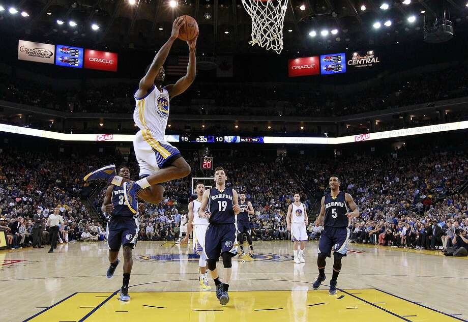 Golden State Warriors' Harrison Barnes (40) goes up for a dunk against the Memphis Grizzlies during the first half of an NBA basketball game Monday, April 13, 2015, in Oakland, Calif. (AP Photo/Marcio Jose Sanchez) Photo: Marcio Jose Sanchez, Associated Press