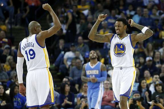 Golden State Warriors' Brandon Rush (4) and Leandro Barbosa (19) celebrate a basket in 4th quarter of 122-79 win over the Denver Nuggets during NBA game at Oracle Arena in Oakland, Calif. on Monday, January 19, 2015.
