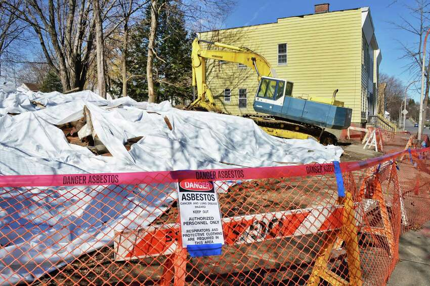 Tarps cover the remains of two collapsed houses on the 200 block of Colonie Street Tuesday April 14, 2015 in Albany, NY. (John Carl D'Annibale / Times Union)