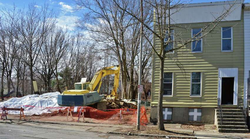 Tarps, left, cover the remains of two collapsed houses on the 200 block of Colonie Street Tuesday April 14, 2015 in Albany, NY. (John Carl D'Annibale / Times Union)