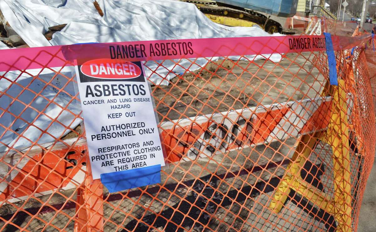 Asbestos warning sign at the scene of two collapsed houses on the 200 block of Colonie Street Tuesday April 14, 2015 in Albany, NY. (John Carl D'Annibale / Times Union)