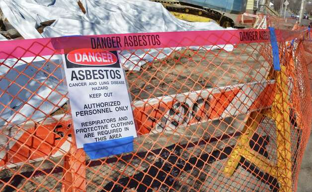 Asbestos warning sign at the scene of two collapsed houses on the 200 block of Colonie Street Tuesday April 14, 2015 in Albany, NY.  (John Carl D'Annibale / Times Union) Photo: John Carl D'Annibale / 00031429A