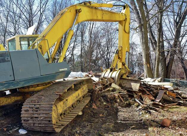 Heavy equipment at the scene of two collapsed houses on the 200 block of Colonie Street Tuesday April 14, 2015 in Albany, NY.  (John Carl D'Annibale / Times Union) Photo: John Carl D'Annibale / 00031429A