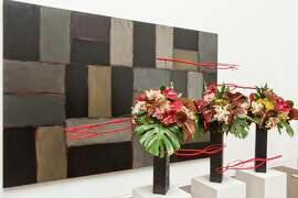 """From """"Bouquets to Art 2015"""": Sean Scully, Wall of Light Horizon, 2005. Oil on canvas. FAMSF, museum purchase, gift of Nan Tucker McEvoy, 2007.2a-b. Floral design by The Tompkison Group The Tompkison Group installation from 2014 Bouquets to Art at the de Young Museum, San Francisco."""