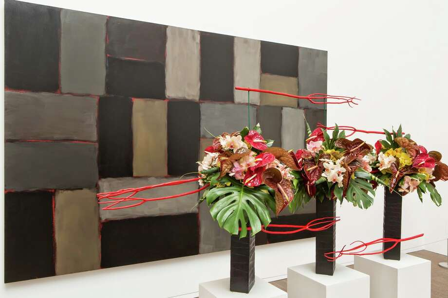 """From """"Bouquets to Art 2015"""": Sean Scully, Wall of Light Horizon, 2005. Oil on canvas. FAMSF, museum purchase, gift of Nan Tucker McEvoy, 2007.2a-b. Floral design by The Tompkison Group The Tompkison Group installation from 2014 Bouquets to Art at the de Young Museum, San Francisco. Photo: Greg A. Lato / ONLINE_YES"""