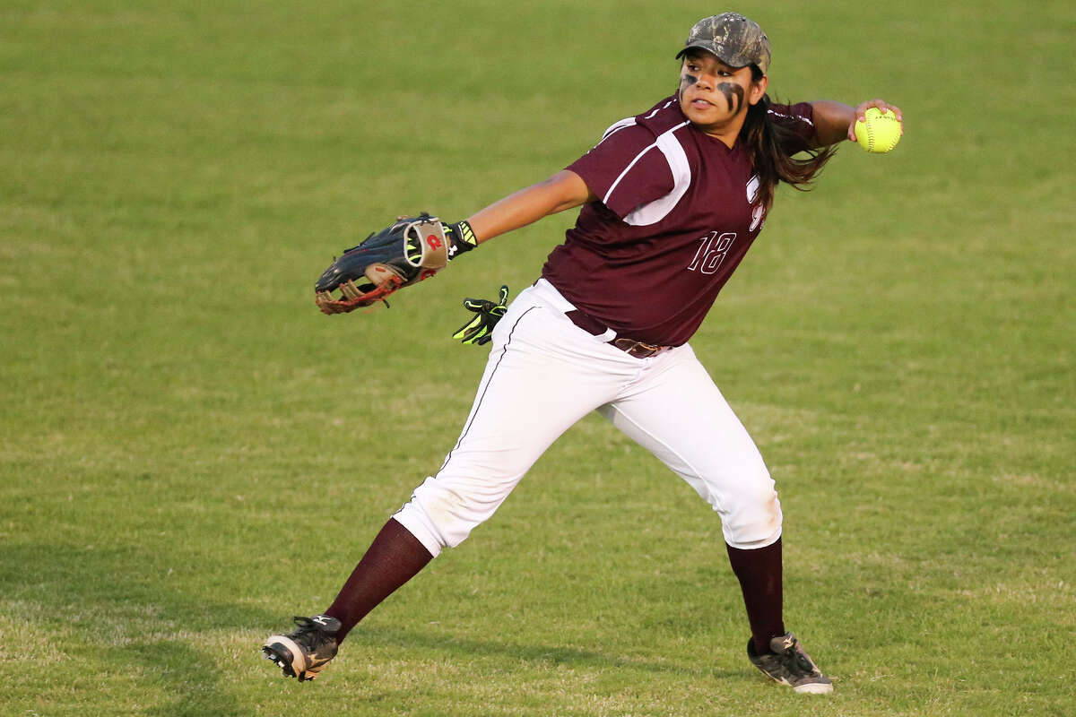 Highlands' Jessica Garza prepares to throw the ball to the infield during the second inning of their game with Lanier at the Mary Ann Villarreal Sports Complex on Tuesday, April 7, 2015. Highlands outscored Lanier 24-9 in the last three innings to beat the Lady Voks 34-26. MARVIN PFEIFFER/ mpfeiffer@express-news.net