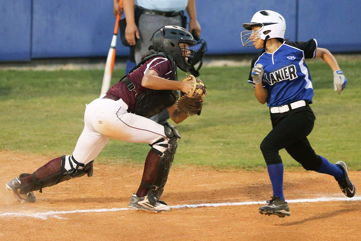 Highlands' Jenelle Rodriguez (left) tries to keep Lanier's Esmi Garza from scoring during the second inning of their game at the Mary Ann Villarreal Sports Complex on Tuesday, April 7, 2015. Highlands outscored Lanier 24-9 in the last three innings to beat the Lady Voks 34-26. MARVIN PFEIFFER/ mpfeiffer@express-news.net