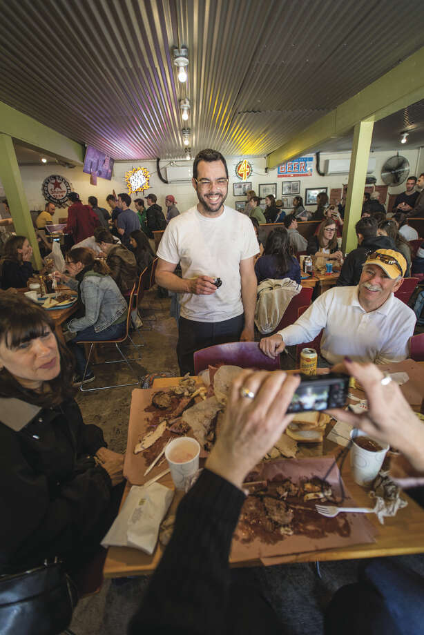 """Aaron Franklin with his customers at Franklin Barbecue, Austin. From his new cookbook, """"Franklin Barbecue: A Meat-Smoking Manifesto"""" (Ten Speed Press). Photo: Wyatt McSpadden / Wyatt McSpadden"""