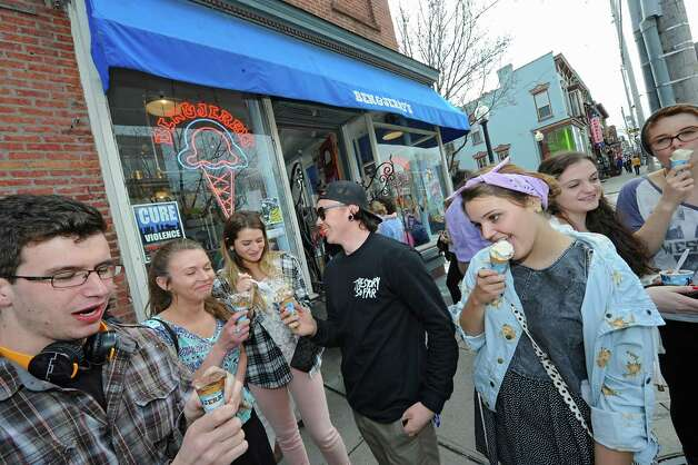 """A group of art students from The College of Saint Rose enjoy some ice cream outside Ben & Jerry's Ice Cream Shop on Lark St. during """"Free Cone Day"""" on Tuesday, April 14, 2015 in Albany, N.Y. Every year the ice cream shop gives away free cones from 12-8pm on this day. (Lori Van Buren / Times Union) Photo: Lori Van Buren, Albany Times Union / 00031428A"""