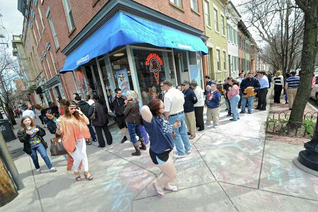 """People wait in line at Ben & Jerry's Ice Cream Shop on Lark St. during """"Free Cone Day"""" on Tuesday, April 14, 2015 in Albany, N.Y. Every year the ice cream shop gives away free cones from 12-8pm on this day. (Lori Van Buren / Times Union) Photo: Lori Van Buren, Albany Times Union / 00031428A"""
