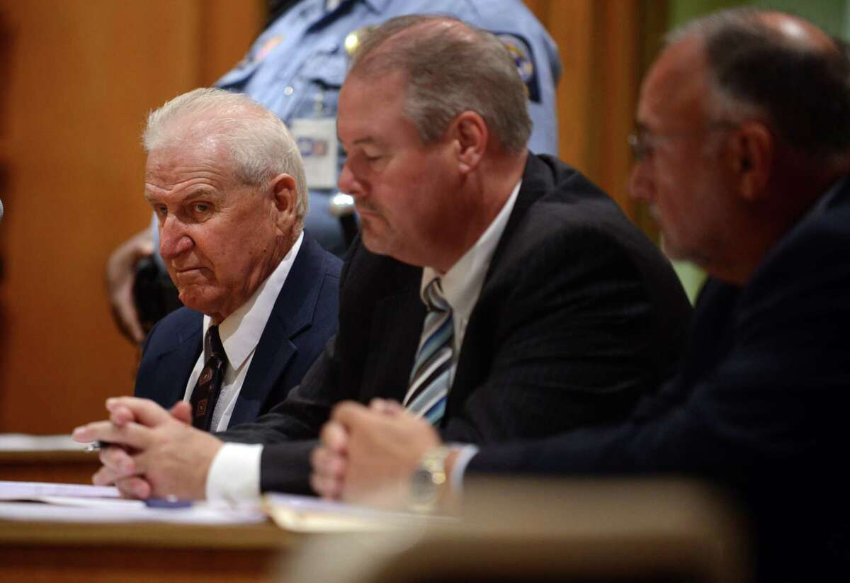 Dominic Badaracco Sr., seated with his defense attorneys Edward Gavin and Richard Meehan, listens as Judge Robert Devlin hands down his sentence in Superior Court in Bridgeport, Conn. on Friday Sept. 13, 2013.