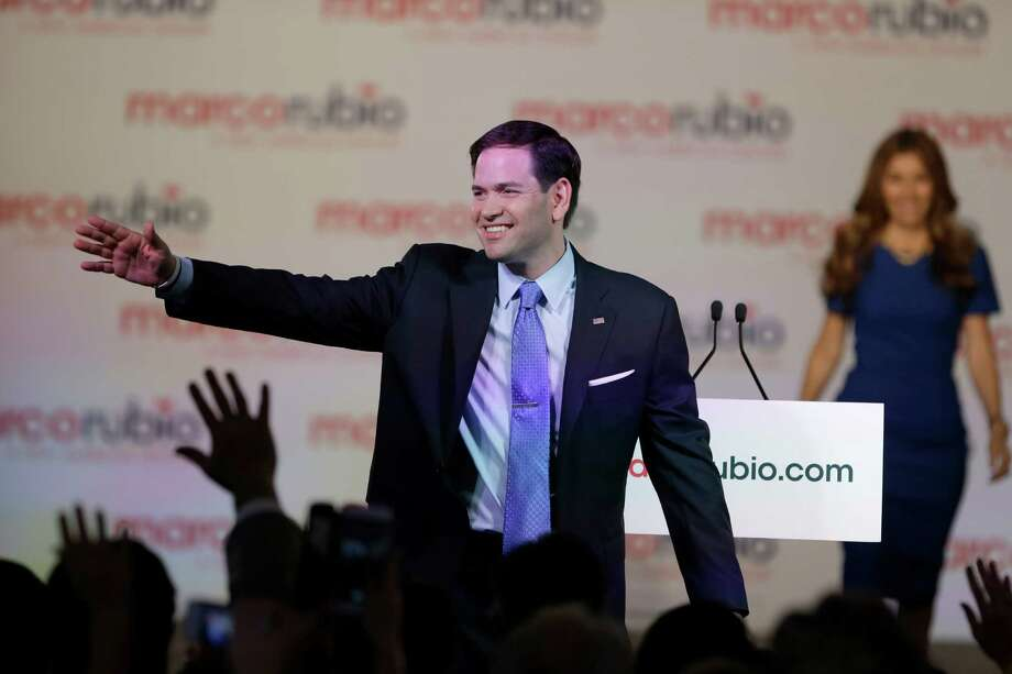 Florida Sen. Marco Rubio waves to supporters as his wife Jeanette joins him on stage, after he announced that he will be running for the Republican presidential nomination, during a rally at the Freedom Tower, Monday, April 13, 2015, in Miami. (AP Photo/Wilfredo Lee) Photo: Wilfredo Lee, STF / AP