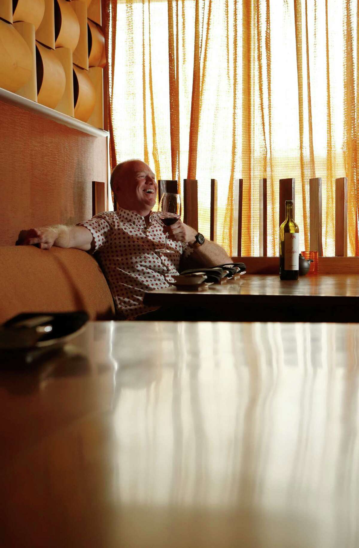 Dale Ellington poses for a portrait with a glass of Agri Maremma Ciliegiolo 2013, from Tuscany, at Kata Robata Wednesday, April 1, 2015, in Houston. ( Jon Shapley / Houston Chronicle )