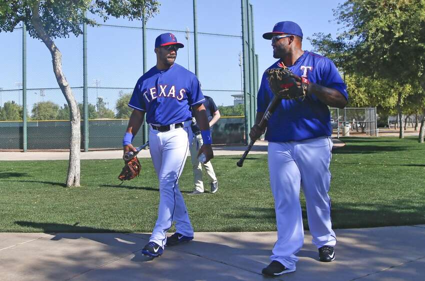 Seattle Seahawks quarterback Russell Wilson, left, talks with Texas Rangers first baseman Prince Fielder as they walk to a practice field prior to a Rangers spring training baseball game against the San Diego Padres Saturday, March 28, 2015, in Surprise, Ariz. (AP Photo/Lenny Ignelzi)
