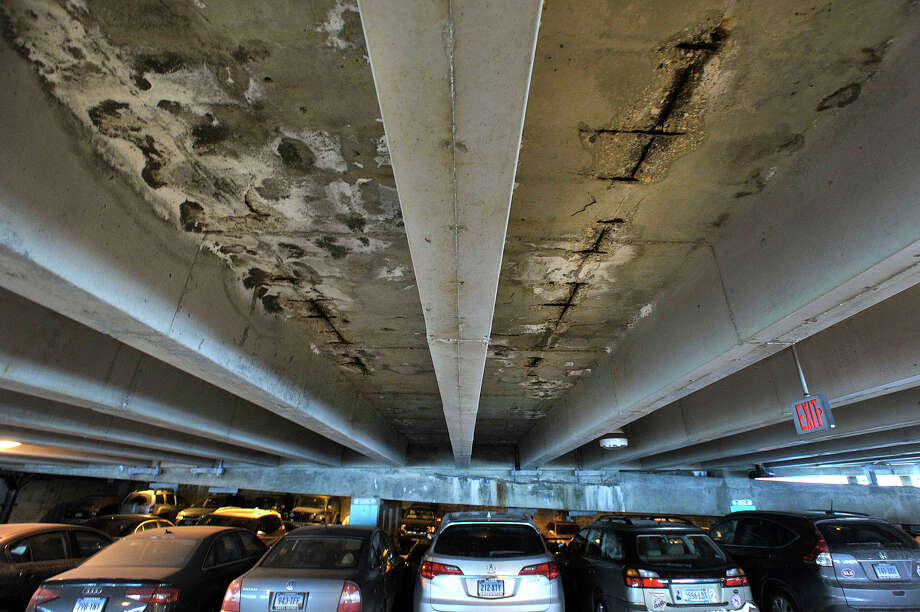 Damage can be seen on the fourth floor of the train station parking garage in Stamford, Conn., on Tuesday, March 3, 2015. Photo: Jason Rearick / Stamford Advocate