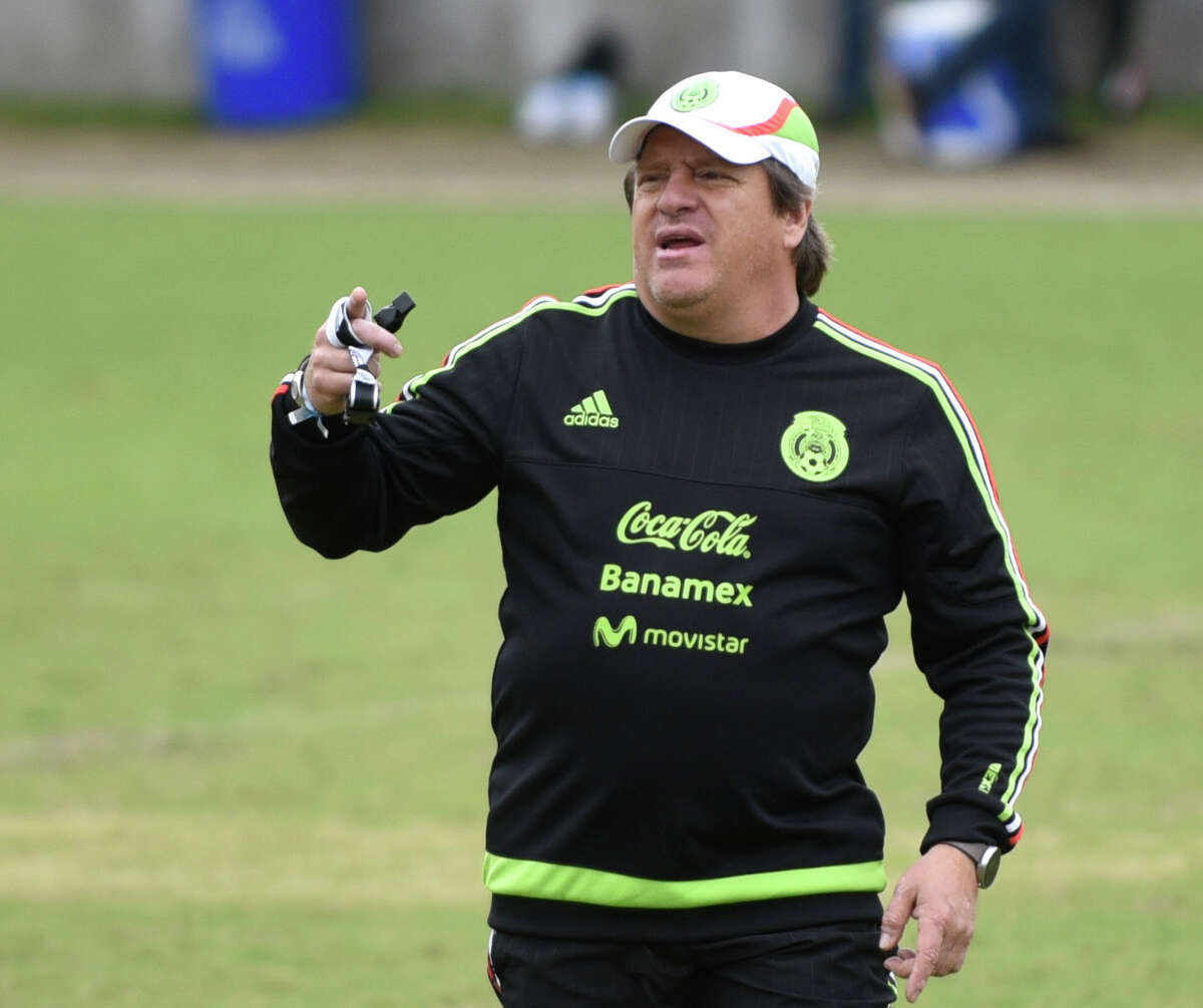 Mexico national team coach Miguel Herrera shouts instruction during a practice at Trinity University on Tuesday, April 14, 2015.