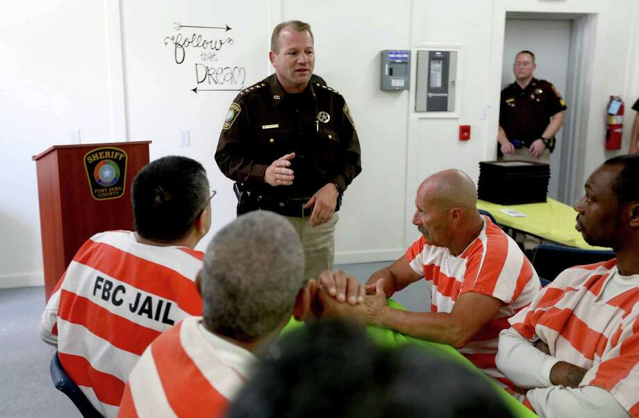 Sheriff Troy Nehls, of the Fort Bend County Sheriff's Office, speaks with 11 inmates before awarding them their Residential Air Conditioning and Wiring Training certification from the Wharton County Junior College Continuing Education Program.     Sheriff Troy Nehls, of the Fort Bend County Sheriff's Office, speaks with 11 inmates before awarding them their Residential Air Conditioning and Wiring Training certification from the Wharton County Junior College Continuing Education Program. Photo: Gary Coronado, Staff / © 2015 Houston Chronicle