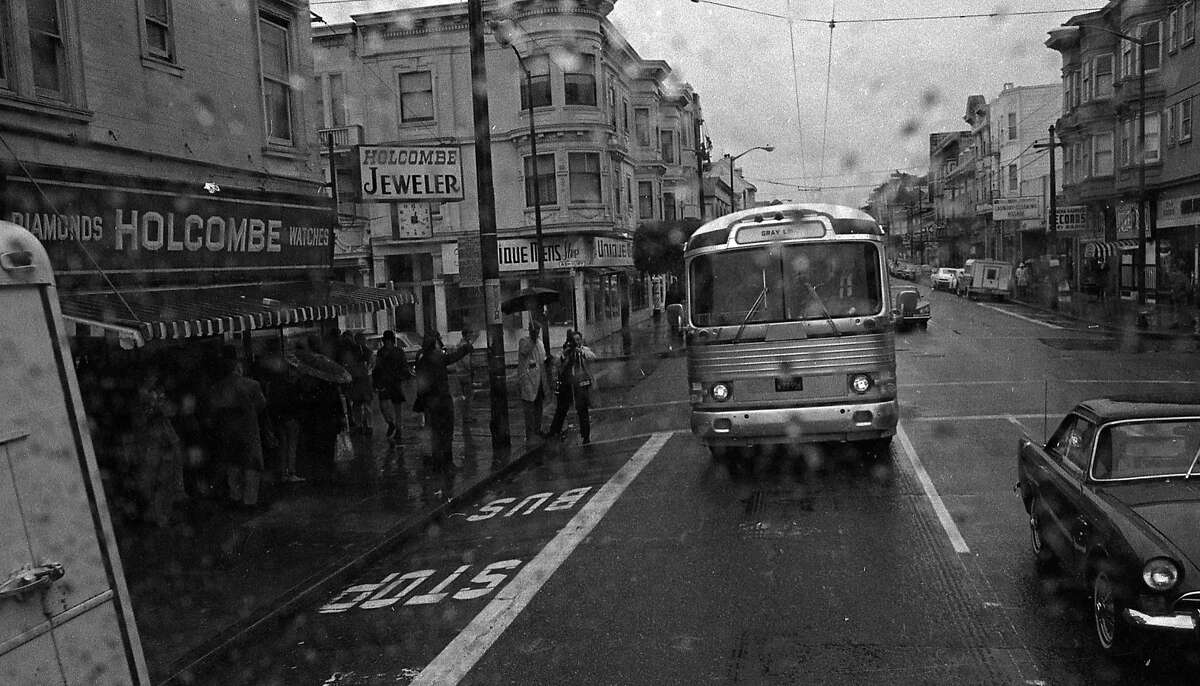 """In 1967, a Gray Line bus takes a """"Hippie Tour"""" through the Haight-Ashbury District in San Francisco."""