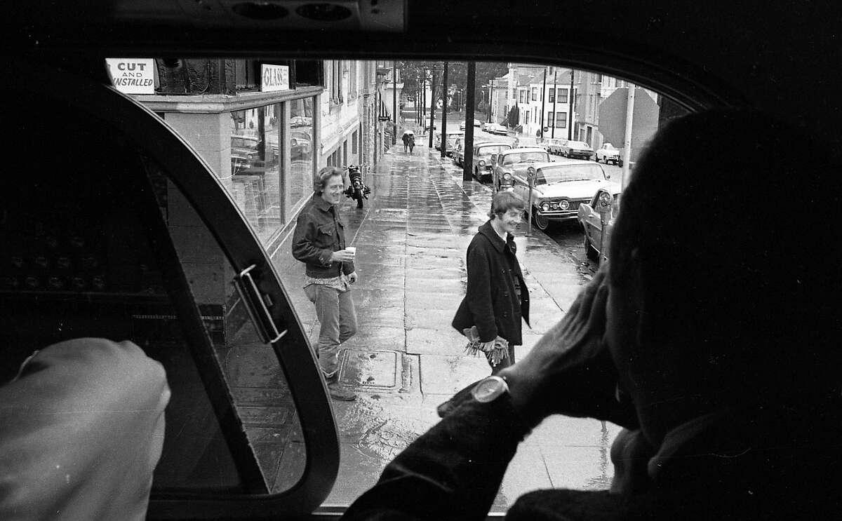 "A Gray Line bus takes a ""Hippie Tour"" through the Haight-Ashbury District in San Francisco on April 26, 1967."