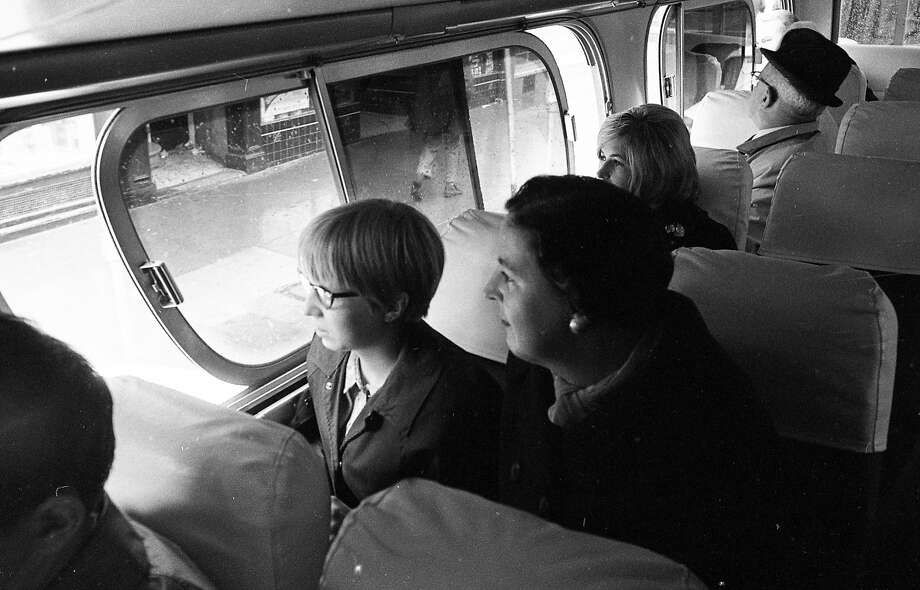"""April 26, 1967: A Gray Line bus takes a """"Hippie Tour"""" through the Haight-Ashbury District in San Francisco. Photo: Art Frisch, The Chronicle"""