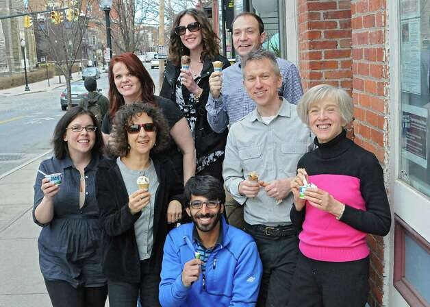 """A group from the office of Parks and Trails New York enjoys ice cream outside Ben & Jerry's Ice Cream Shop on Lark St. during """"Free Cone Day"""" on Tuesday, April 14, 2015 in Albany, N.Y. Every year the ice cream shop gives away free cones from 12-8pm on this day. (Lori Van Buren / Times Union) Photo: Lori Van Buren / 00031428A"""