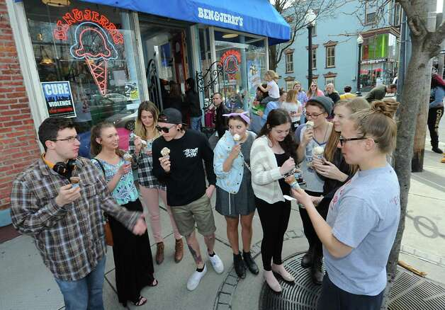 """Art students from The College of Saint Rose enjoy some ice cream outside Ben & Jerry's Ice Cream Shop on Lark Street during """"Free Cone Day"""" on Tuesday, April 14, 2015 in Albany, N.Y. Every year the ice cream shop gives away free cones from 12-8pm on this day. (Lori Van Buren / Times Union) Photo: Lori Van Buren / 00031428A"""