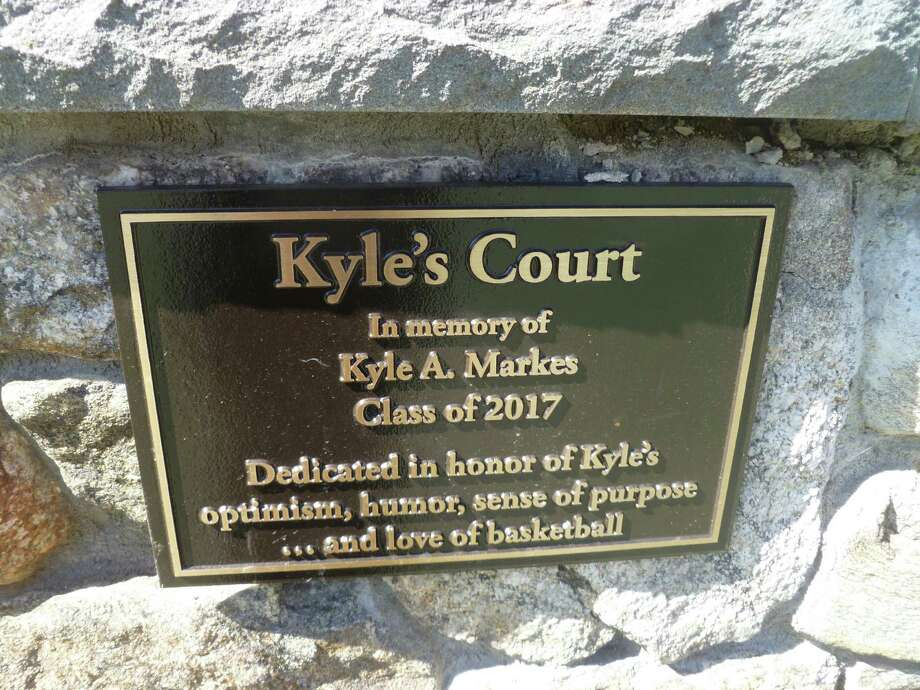 A memorial plaque dedicates the basketball courts at New Canaan Country School to the memory of Kyle A. Markes, a Country School student who died of childhood leukemia at the age of 11 in December 2013. Photo: Martin Cassidy / New Canaan News
