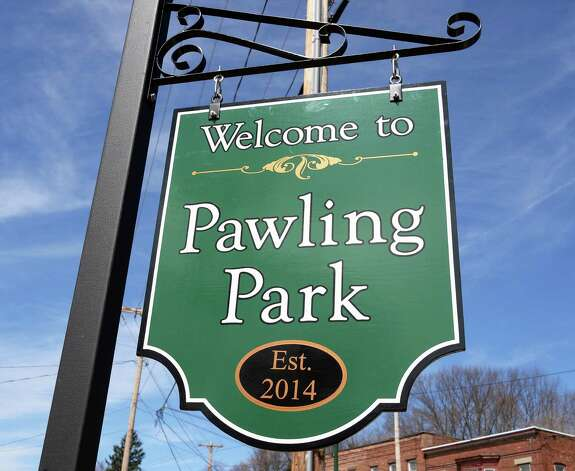 "The new sign at Troy's newest park, the Col. Albert Pawling Memorial Park or ""Pawling Park""  at the corners of Congress Street and Pawling Avenue on Tuesday April 14, 2015 in Troy, NY.  (John Carl D'Annibale / Times Union) Photo: John Carl D'Annibale / 00031424A"