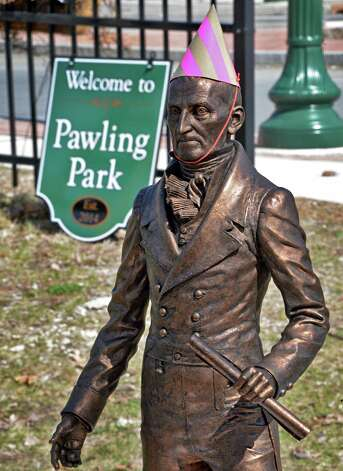 "A model of the Col. Albert Pawling Memorial Statue, Troy's first mayor, wearing a birthday hat, during the dedication of Troy's newest park, Col. Albert Pawling Memorial Park or ""Pawling Park""  at the corners of Congress Street and Pawling Avenue on Tuesday April 14, 2015 in Troy, NY.  (John Carl D'Annibale / Times Union) Photo: John Carl D'Annibale / 00031424A"
