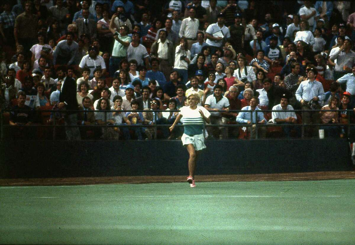 Morganna Roberts makes a dash for Astros pitcher Nolan Ryan on April 9, 1985.
