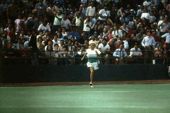 Morganna Roberts makes a dash for Astros pitcher Nolan Ryan, April 9, 1985.