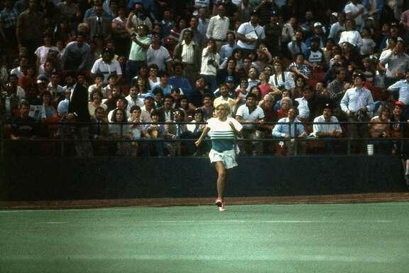 Morganna Roberts makes a dash for Astros pitcher Nolan Ryan, April 9, 1985.