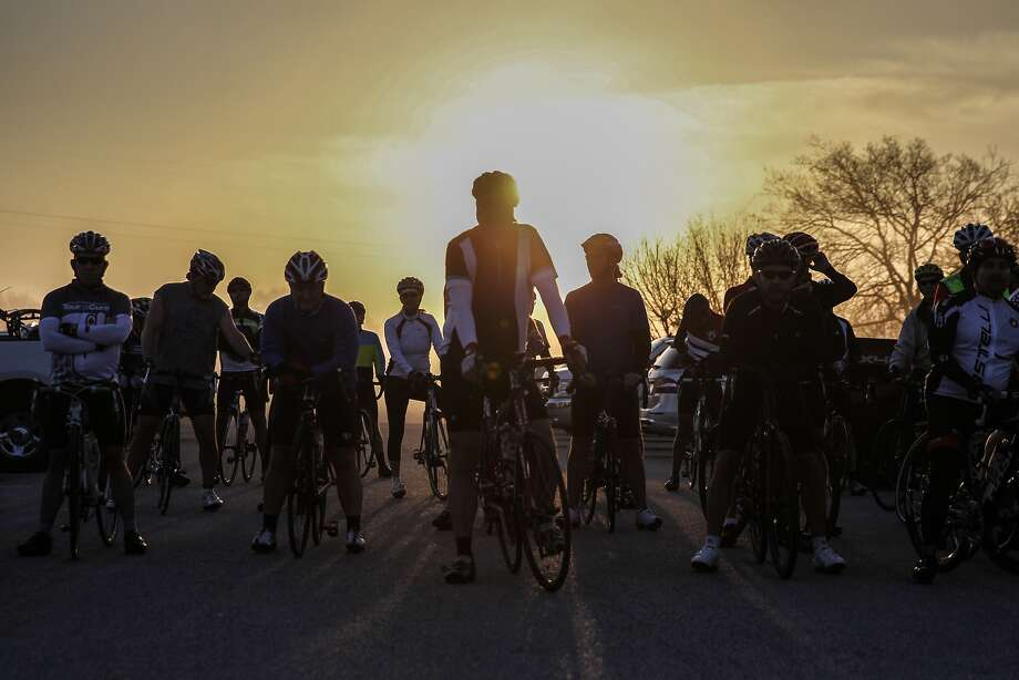 Members of the Northwest Cycling Club gather at sunrise for a Saturday morning ride out of Zune Park in Cypress on March 14, 2015. Photo: Diana L. Porter, Freelance / © Diana L. Porter