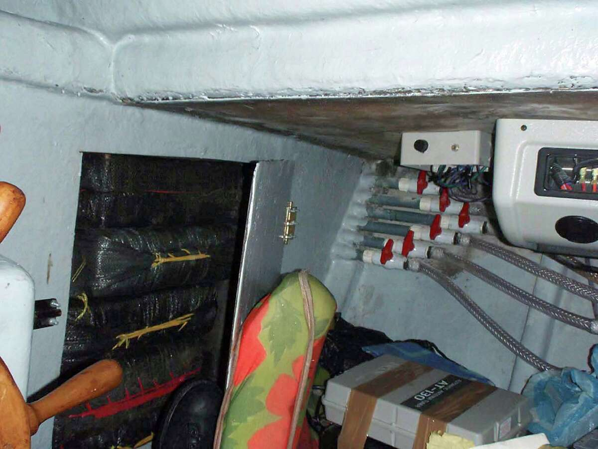 In this photo provided by the US Navy, packages of cocaine are stored in a compartment of a self-propelled, semi-submersible vessel. This was also part of the Sept. 13, 2008 haul by the USS McInerney. The seized vessel has the capability to travel from Ecuador to San Diego, Calif.