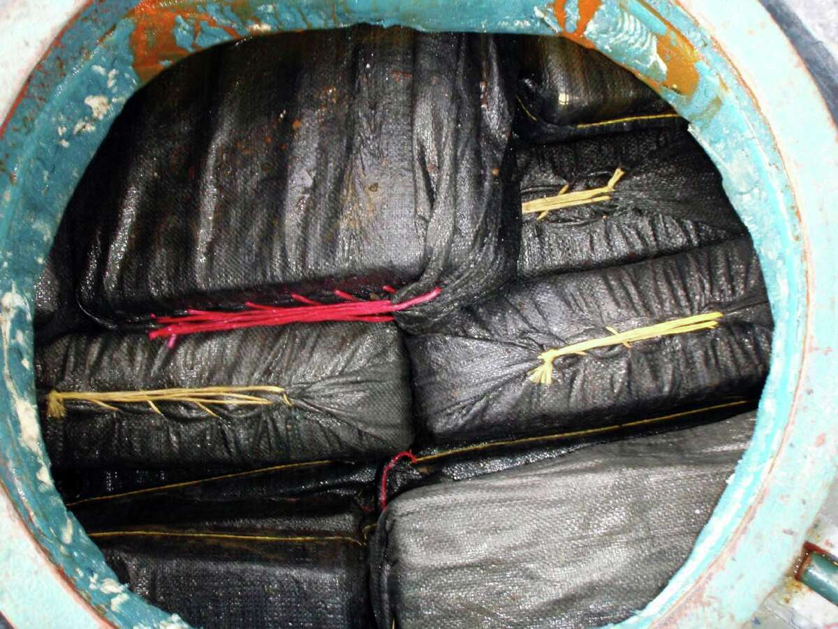 In this photo provided by the U.S. Navy, a portion of 37 bales of cocaine are seen in one of the compartments of a self-propelled, semi-submersible vessel that was caught Sept. 13, 2008, by the  USS McInerney. Nearly 7 tons of cocaine (estimated at $187 million) was seized during a night raid about 350 miles west of Guatemala in the Pacific Ocean. Scroll through the gallery to see how cartels ship their contraband on the open ocean. (U.S. Navy photo by Petty Officer 1st Class Nico Figueroa/Released)