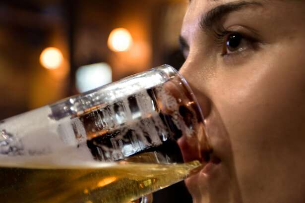 Woman drinking beer in a bar alcohol