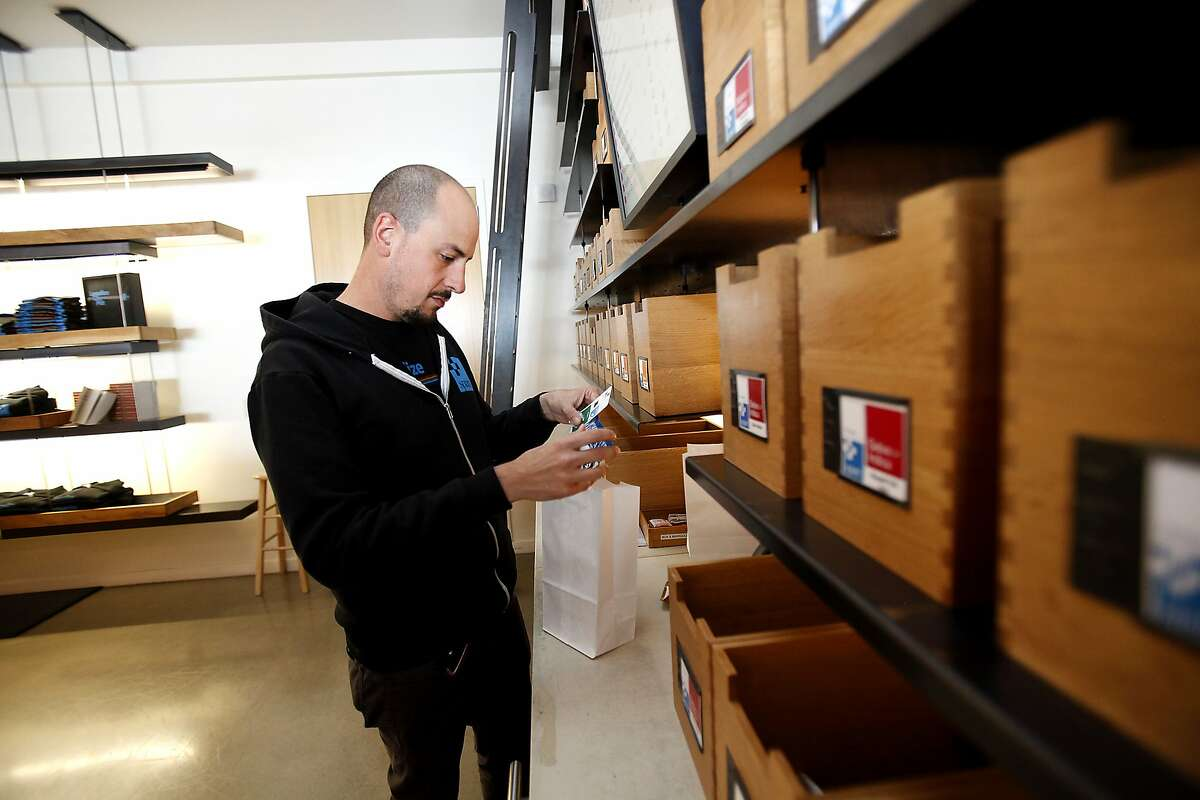 Jason Ayestas shows how items are packaged for delivery at SPARC, a cannabis dispensary in San Francisco, Calif., on Tuesday, April 14, 2015. The club will be one of the suppliers to on-demand marijuana delivery startups.