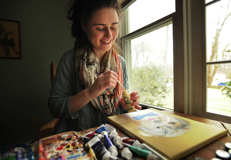 Annie Blumenfeld, 16, paints whimsical pet portraits to fund her non-profit charity Wags 4 Hope, at her home in Fairfield, Conn. on Tuesday, April 14, 2015. Blumenfeld donates proceeds to fund animal shelters treatment of dogs with heartworm disease. Photo: Brian A. Pounds / Connecticut Post